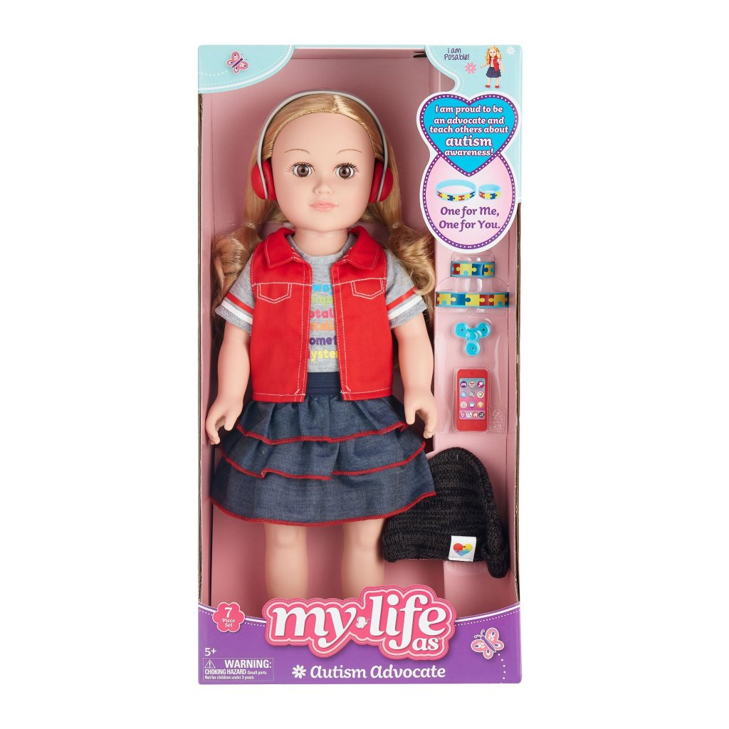 "Image of the blonde version of Walmart's ""Autism Advocate"" version of their My Life As dolls. It comes with headphones and puzzle piece accessories"